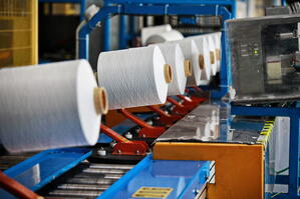 Textile manufacturing hot glue